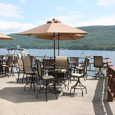 Lakeside patio with tables and umbrellas