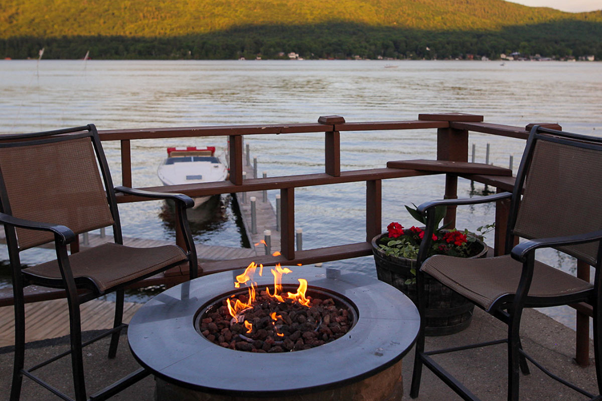 Fire pit on the deck by Lake George waters edge