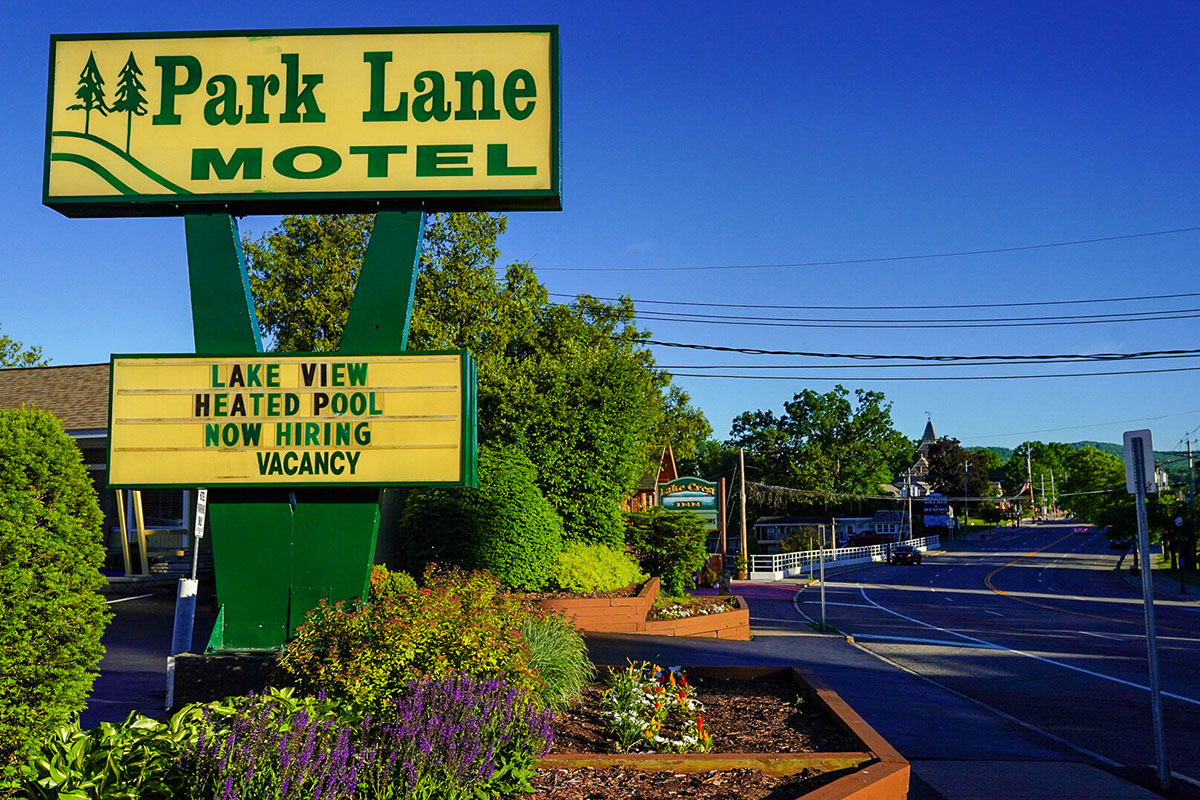 Park Lane Motel front road sign in the middle of Lake George