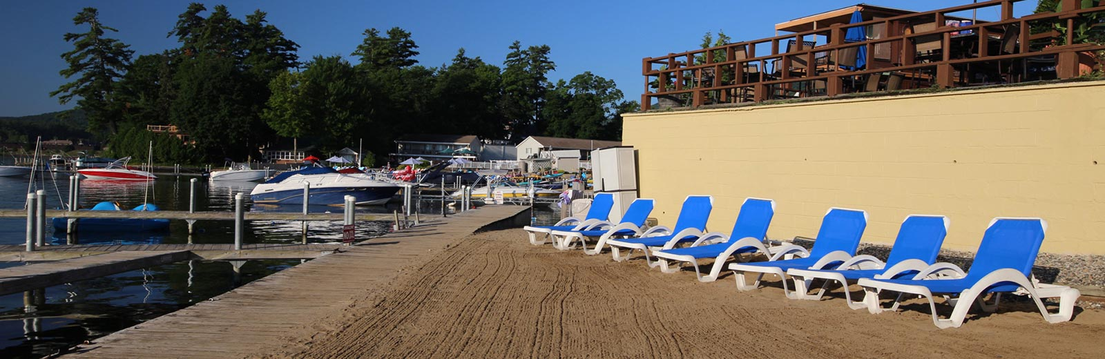Blue chairs line the beach